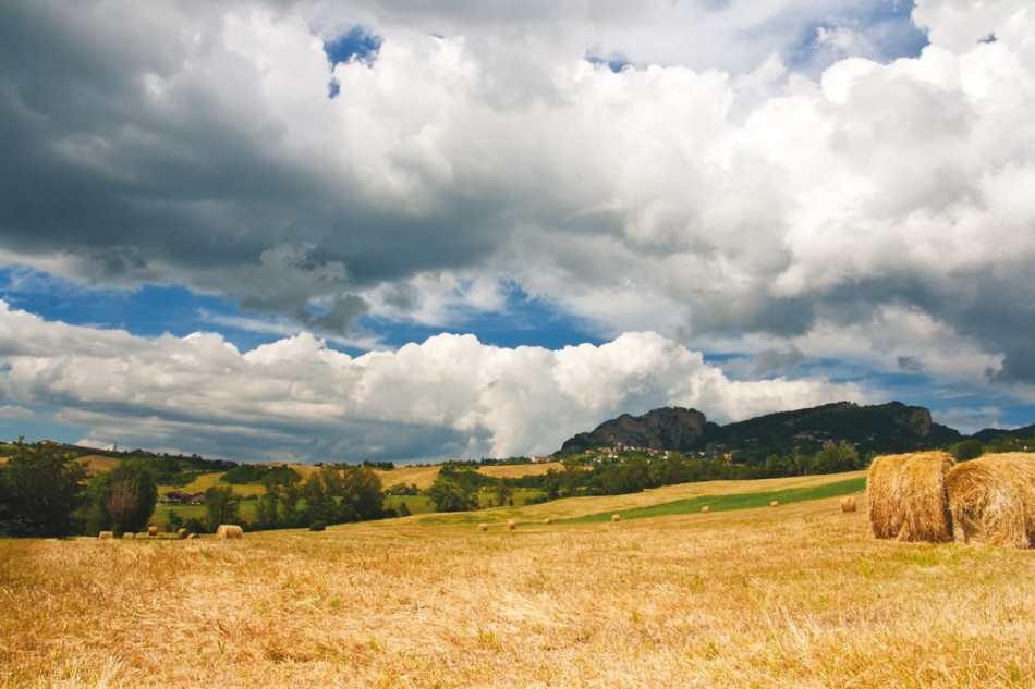 Countryside of le Marche, Italy, with hay balls and cloudy sky