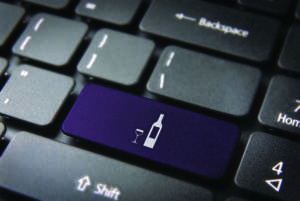 Food key with Wine bottle and cup icon on laptop keyboard. Included clipping path, so you can easily edit it.